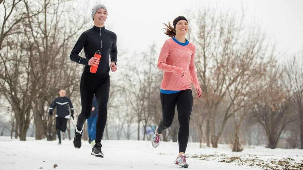 two people running in snow