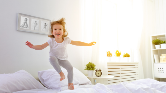 child jumping on bed due to sleep difficulties