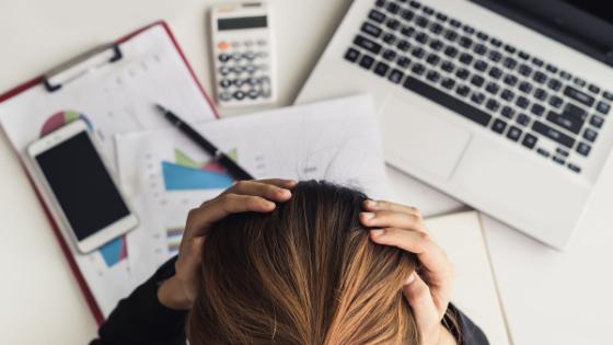 mental health awareness at work - stressed woman