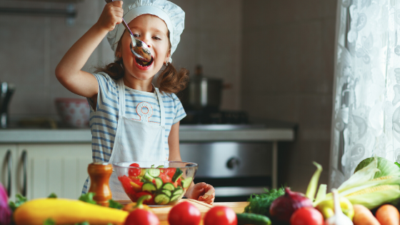 child making food based on intuitive eating principle of mindful eating