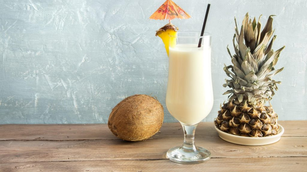 healthy pina colada in glass with straw