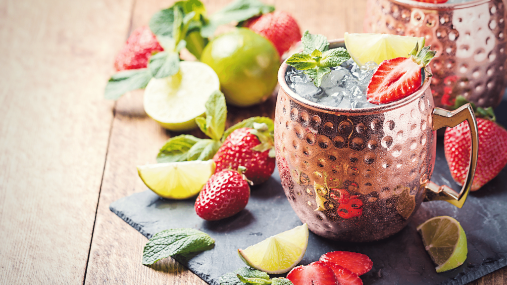 strawberry moscow mule in a copper mug, a perfect summer drink recipe
