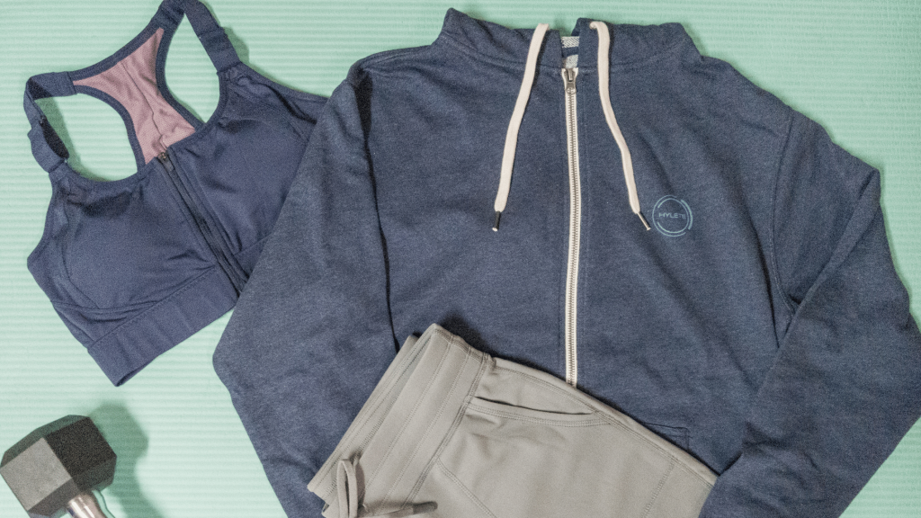 flatlay of HYLETE hoodie, joggers, and sports bra
